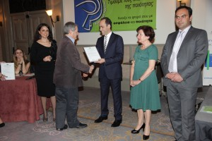 Dr Michael I. Loizides receives ISOTECH's certificate from the Minister of Finance